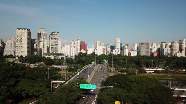 Sao Paulo Aerial view of a bridge crossing Marginal Pinheiros at Sao Paulo city. Manu buildings on background. marginal pinheiros stock videos & royalty-free footage