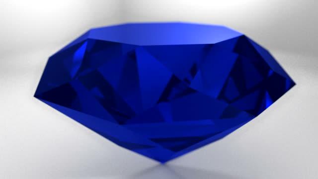 Sapphire blue diamond gemstone gem stone spinning wedding background loop video