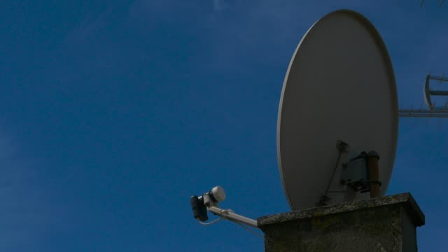 satellite dish installed on the roof of building satellite dish installed on the roof of building cable tv stock videos & royalty-free footage