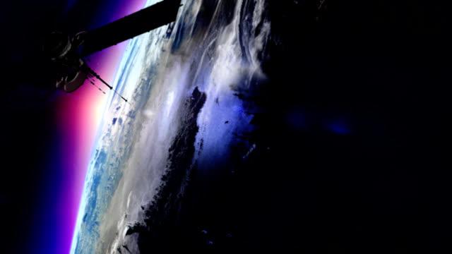 Satellite in orbit around the earth video