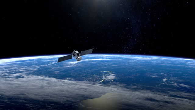 Video Satellite. Tthe satellite flies faraway from camera. The earth is spinning rapidly. 4K. NASA.