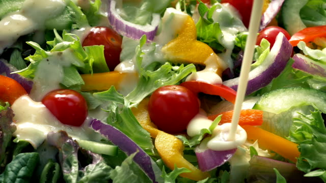 Sauce Pours On Colorful Salad Dish video