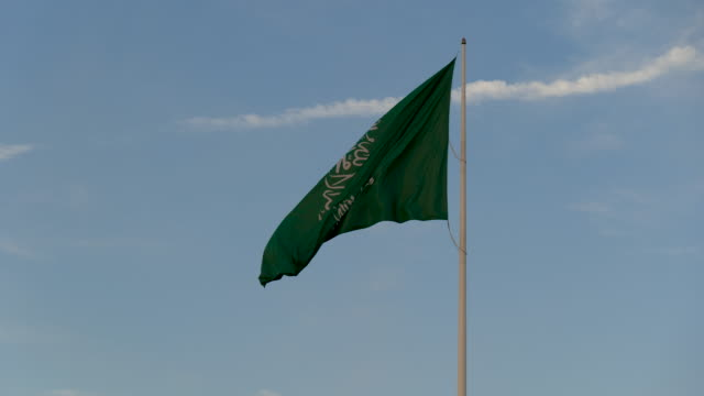 saudi arabia flag blowing in wind - paesi del golfo video stock e b–roll