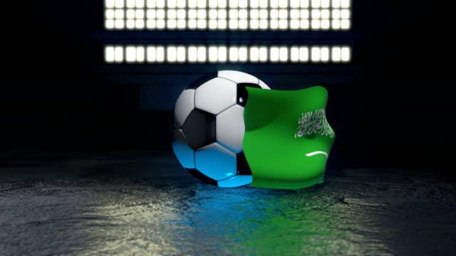 축구 공을 주위에 사우디 아라비아 국기 파리 - saudi national day 스톡 비디오 및 b-롤 화면
