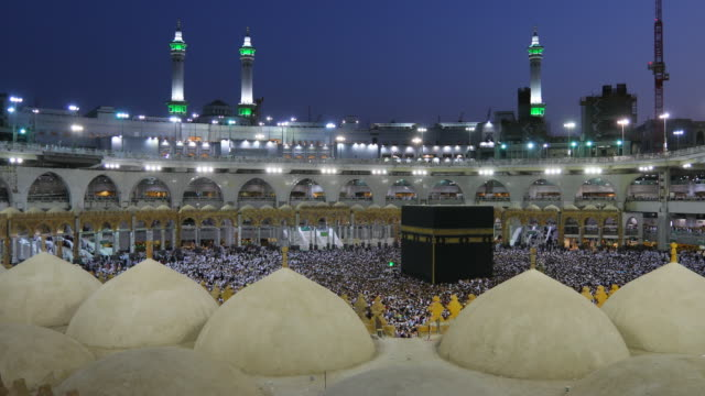 Saudi Arabia. Pilgrims circumambulate seven times to show their submission to the religion video