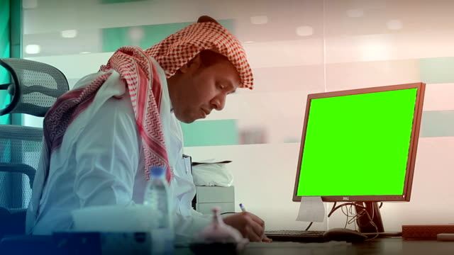 saudi young working on computer video