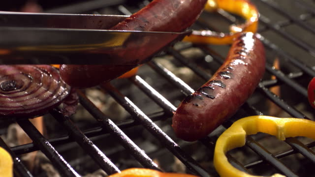 Sausage and vegetables on barbecue grill video