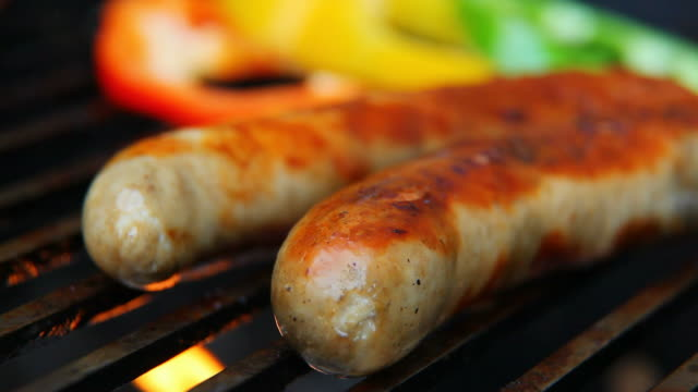sausages grilled on fire video