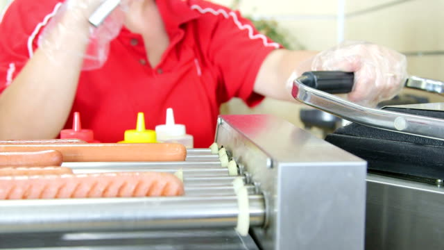 Sausages hot dogs on grills in fast food lunch dinner video