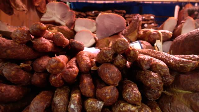 vídeos de stock e filmes b-roll de sausages  meat products - produto de carne