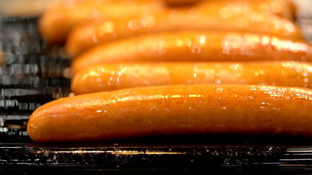 CU sausages on rolling grill Three close up shots of sausages cooked on rolling grill hot dog stock videos & royalty-free footage