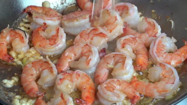 sauteed prawns with garlic, white wine reduction and butter - seafood stock videos and b-roll footage