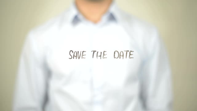 Save the Date, Man Writing on Transparent Screen video