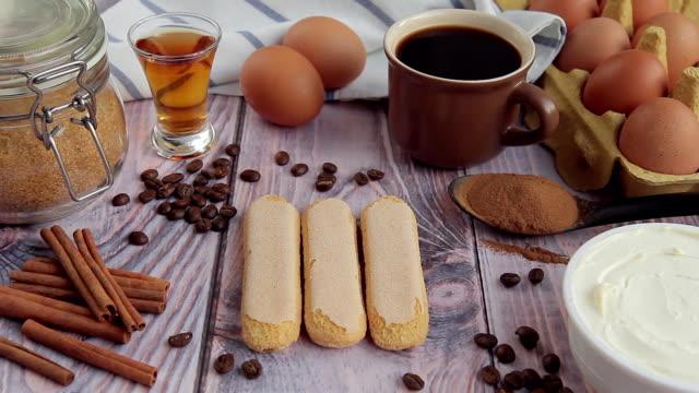 Savoiardi cookie stacked on wooden table in kitchen