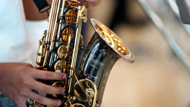 Saxophonist. Hands holding alto saxophone performance at concert. video