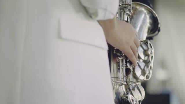 Saxophonist perform on stage.