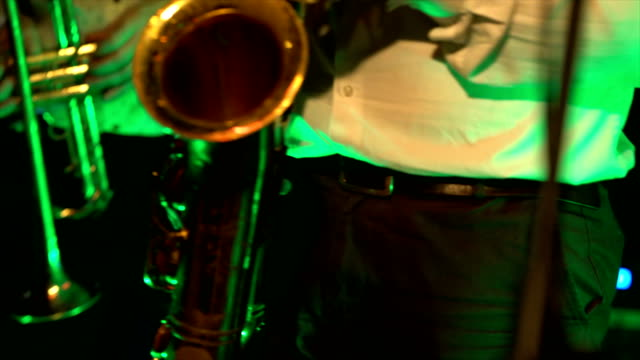 Saxophonist play on golden saxophone. Live performance video