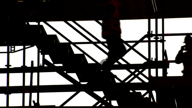 scaffolding with workers descending stairs video