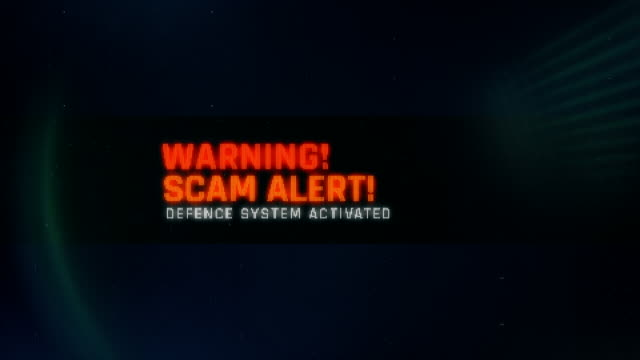 Scam alert, defence system activated, warning message on screen