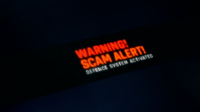 Scam alert detected, defence system activated, vulnerability found, screen text