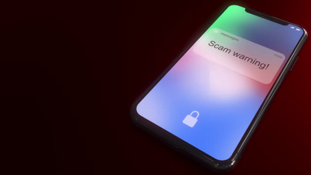 Scam warning message pops up on the screen of a phone Notification pops up on the screen of a modern smartphone. Conceptual 3D animation fraud stock videos & royalty-free footage