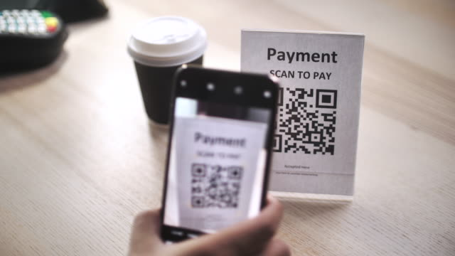 Scan to pay, QR code cashless payment contactless payment through smart phone to buy take away coffee at counter bar in coffee shop cafe, slow motion Scan to pay, QR code cashless payment contactless payment through smart phone to buy take away coffee at counter bar in coffee shop cafe, slow motion contactless payment stock videos & royalty-free footage