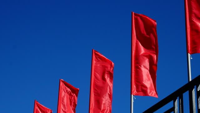 Scarlet flags.