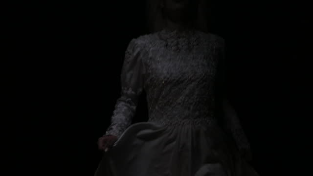 Scary bride Witch in white going through dark wood ghost stock videos & royalty-free footage
