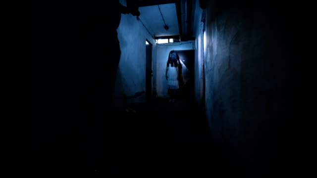 Scary ghost in basement Scary girl ghost in basement being pursued by a secret agent. anticipation stock videos & royalty-free footage