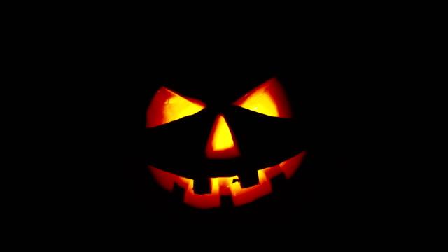 Scary old jack-o-lantern on black background.