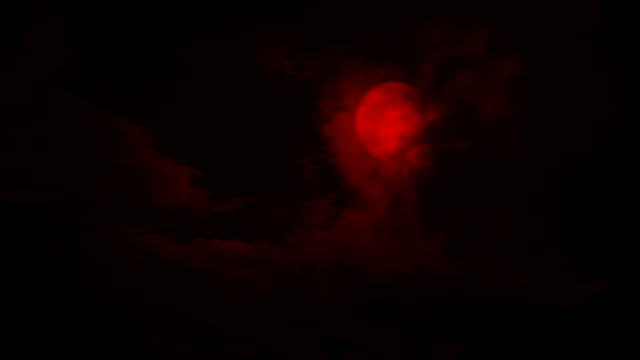 Scary Red Moon Comes Out From Behind Clouds Night sky with big clouds moving across a red moon count dracula stock videos & royalty-free footage