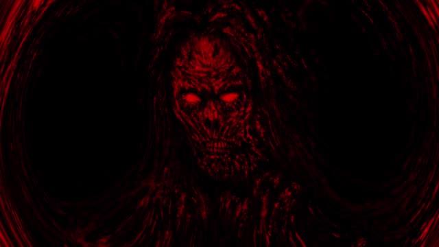 spaventoso volto zombie rosso che emerge dall'oscurità - inferno video stock e b–roll