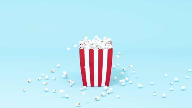 vídeos de stock, filmes e b-roll de pipoca espalhada, comida doce, renderização 3d. - balde pipoca