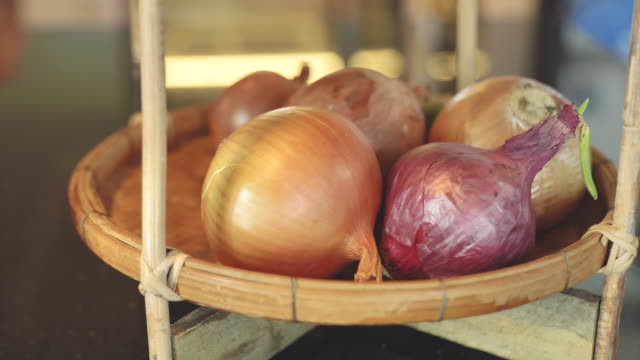 scene dolly shot close up of raw onion in kitchen at home, concept of day in the life objects - cipolla video stock e b–roll