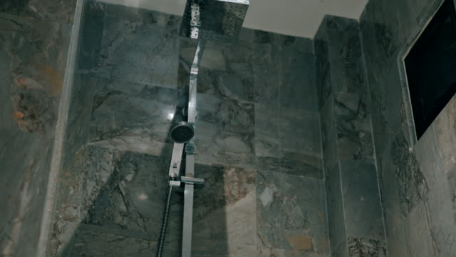 Scene dolly shot of metal shower head modern style in the bathroom, Concept of day in the life objects