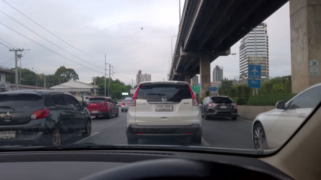 Scene POV of driving on the road at bangkok in thailand, View from car front window