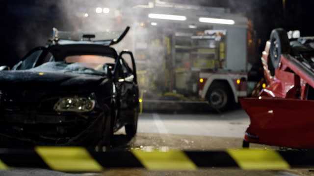 DS Scene of a car accident at night secured with a barricade tape Wide dolly shot of the scene of a car accident late at night secured with a barricade tape. Shot in Slovenia. car accident stock videos & royalty-free footage