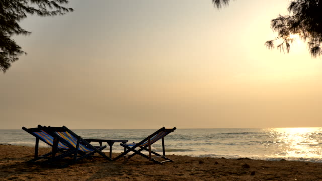 Scene of beautiful tropical beach and sea with umbrella and chair lounge for holiday and travel