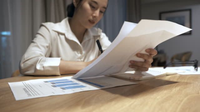 Scene of business asian woman working at home with her paper work