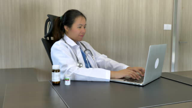 Scene of doctor working using laptop at office, Concept of Technology, Concept of healthcare and medicine