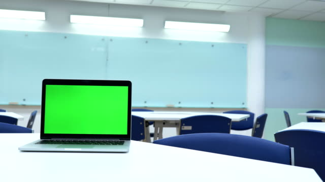 Scene of laptop computer showing green chroma key screen stands in the classroom. Technology In the Background , Concept of technology background, Back to school
