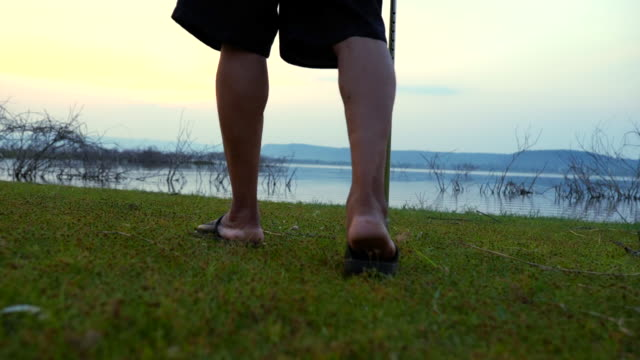Scene of Senior asian male walking with stick in the nature , concept healthy, slow motion