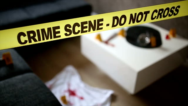 Scene of the crime Scene of the crime.Close-up view of crime scene tape blocking an entrance.Police line. crime scene stock videos & royalty-free footage