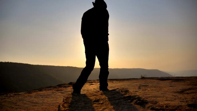 Scene slow motion silhouette of adventure , travel, tourism, hike and people concept, freedom man