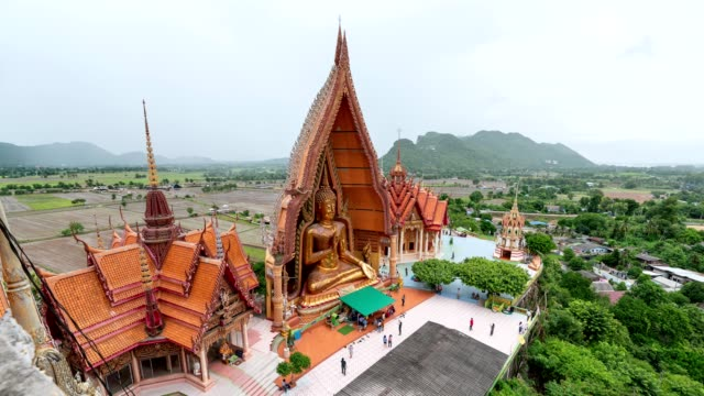 Scenery of golden pagoda with big buddha on hill at Wat Tham Sua