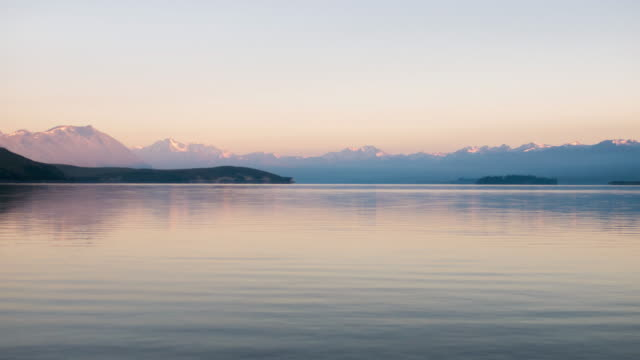 Scenery of Tekapo lake at sunrise time , Canterbury , new zealand , Time lapse movement video