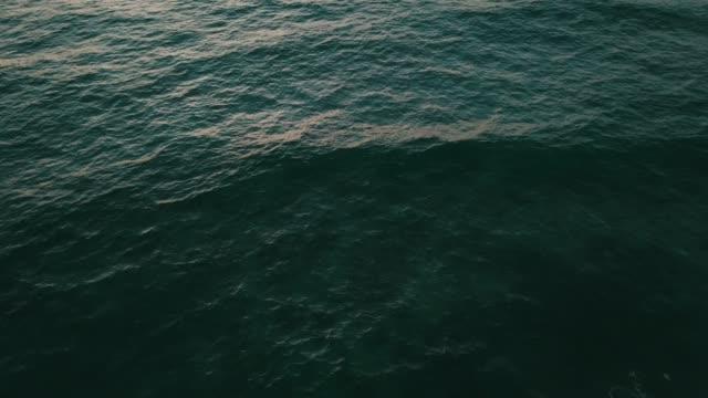 scenery seascape with sunset background top view - krajobraz morski filmów i materiałów b-roll