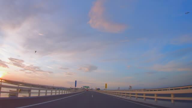 scenery seen from inside a car running on a highway - wagon kolejowy filmów i materiałów b-roll