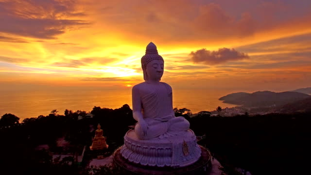 scenery sunset behind phuket big buddha landmark of phuket island - phuket video stock e b–roll
