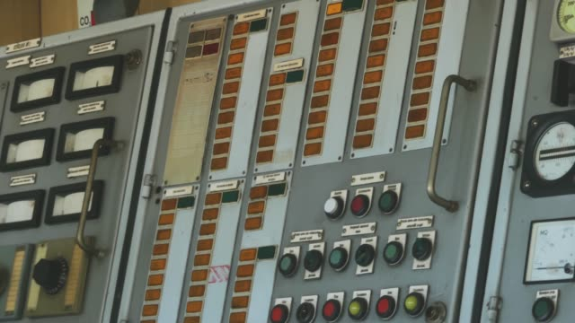 Scenes inside the control room of the bridge of a ship. Navigation dashboard in a ship. captain control communication room, hand push a button. Ship control panel with toggle switches. Close up